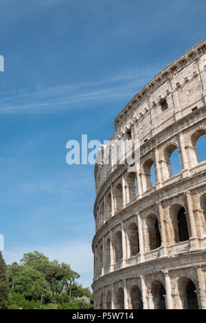 Exterior of the ancient Colosseum in Rome - the largest amphitheatre ever built - Stock Photo