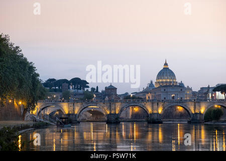 The dome of St. Peter's church and St. Angelo bridge in the historical centre of Rome - Stock Photo