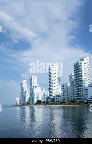The skyline of apartment blocks in the upmarket Bocagrande neighbourhood in central Cartagena on the Caribbean coast of Colombia, South America - Stock Photo