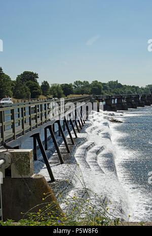 view across teddington lock weir, on the river thames in southwest london, england - Stock Photo