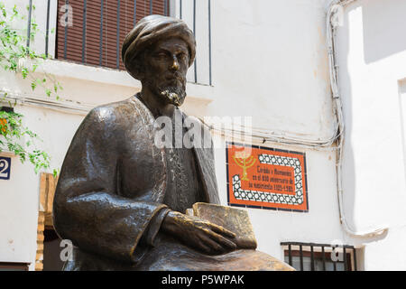 Close-up view of the statue of the Jewish philosopher Maimonides sited outside the Synagogue (Sinagoga) in the Juderia area of Cordoba, Spain. - Stock Photo