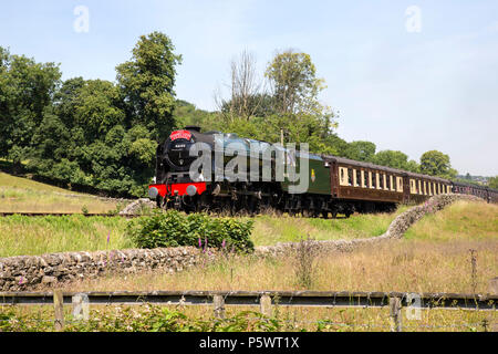 LMS steam locomotive Royal Scot class 6100 hauling a pullman train on the Keighley and Worth Valley heritage line during the 50th Anniversary gala - Stock Photo