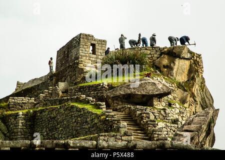Archaeologists at work, Machu Picchu Inca ruins, near Aguas Calientes, aka Machu Picchu Pueblo, Cusco, Peru