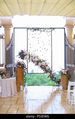 Wedding arch decoration inside. - Stock Photo
