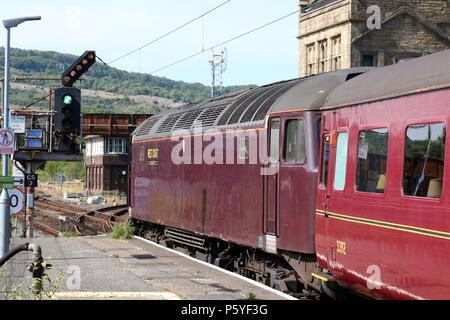 West Coast Railway Company empty coaching stock working leaving Carnforth railway station top and tailed by two diesel-electric locomotives. - Stock Photo
