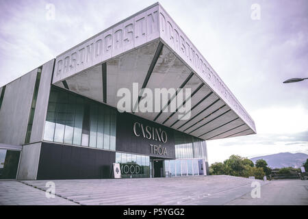 June 20th, 2018, Troia, Portugal - the Troia Casino, a contemporary casino with gaming tables, slot machines, a stage & bar at an upscale hotel. - Stock Photo