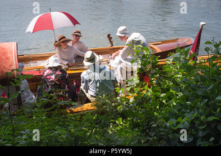 Party in their traditional vintage boats by the towpath at Henley Royal Regatta, Oxfordshire, UK - Stock Photo