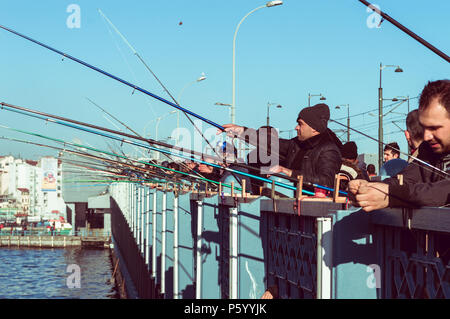 Istanbul, Turkey - January 06, 2018: Local fishermen fishing on Galata Bridge to relax and enjoy their hobby in Istanbul, Turkey. - Stock Photo
