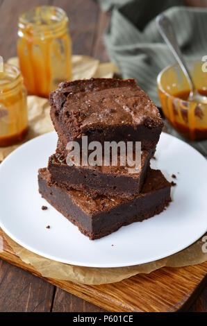 Tasty Brownies with Caramel Sauce, Homemade Chocolate Dessert - Stock Photo