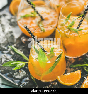 Refreshing alcoholic summer cocktail in glasses on tray, square crop - Stock Photo