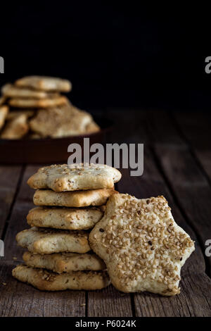 Star shaped biscuits with sesame seeds, made with Sicilian recipe, for winter holidays. - Stock Photo