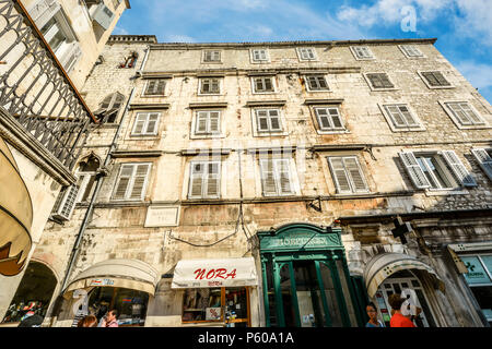 Apartments above shops and stores in Peoples Square, Diocletians Palace in old town Split Croatia on a sunny day - Stock Photo