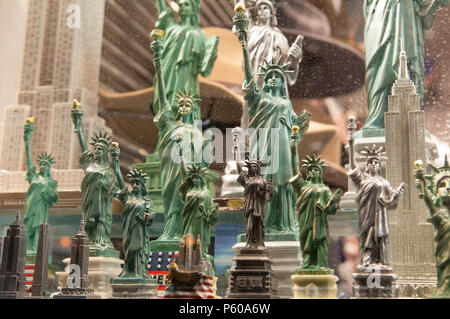 Cheap models of The Statue of Liberty on sale for tourists in a shop window in Manhattan, New York City - Stock Photo