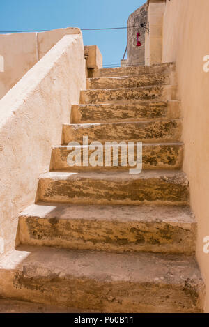 Stone steps leading up to the roof of a traditional Maltese house. - Stock Photo