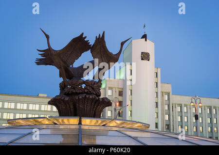 Minsk, Belarus. Famous Independence Square with beautiful sculpture of storks and the building of the Minsk Subway Administration - Stock Photo