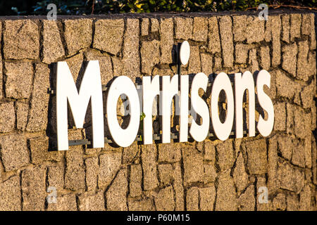 A Morrisons supermarket sign, located opposite their branch in Penzance - Stock Photo