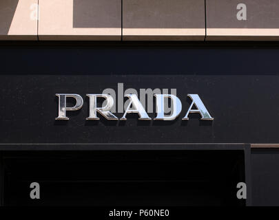 Copenhagen, Denmark - June 26, 2018: Prada logo on front store in shopping street. Prada is a world famous fashion brand founded in Italy. - Stock Photo