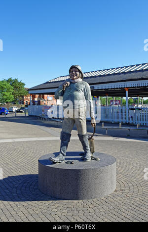 The famous 'Jolly Fisherman' statue at the railway station in the seaside town of Skegness, Lincolnshire,UK - Stock Photo