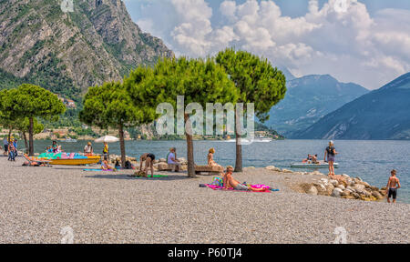People at the beach, Limone sul Garda, Lake Garda, Brescia province, Lombardy, Italy, Europe - Stock Photo