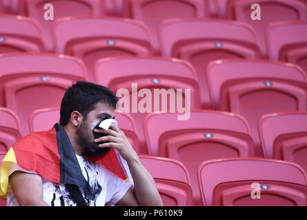 Kazan, Russia. 27th June, 2018. A fan of Germany reacts after the 2018 FIFA World Cup Group F match between Germany and South Korea in Kazan, Russia, June 27, 2018. South Korea won 2-0. Credit: Chen Yichen/Xinhua/Alamy Live News - Stock Photo