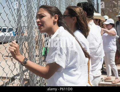 June 26, 2018 - FILE - In a historic upset, Alexandria Ocasio-Cortez, a 28-year-old former Bernie Sanders organizer, defeated Democratic incumbent Rep. Joe Crowley in the race for New York's 14th Congressional District. PICTURED: June 24, 2018 - Tornillo, Texas, U.S. - ALEXANDRIA OCASIO-CORTEZ, a congressional candidate from the New York 14, stood shaking the fence with other protesters shouting toward federal immigration agents asking them to stop the separation of children and return the children housed in the tents near the Tornillo-Guadalupe Toll Plaza. (Credit Image: © Josh Bachman via ZU - Stock Photo