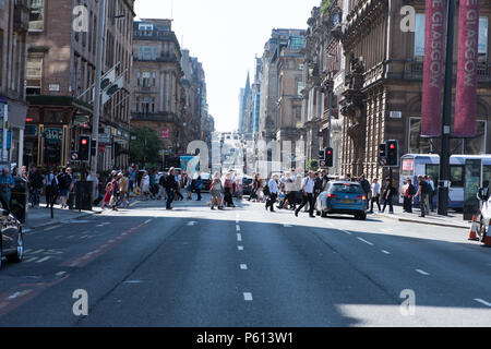 Glasgow, UK. 27th Jun, 2018. UK Weather: Crowds cross Buchanan Street and St Vincent Street junction in the sunshine Credit: Tony Clerkson/Alamy Live News - Stock Photo