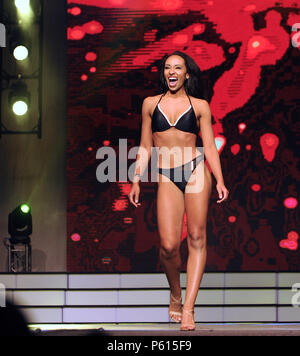 Lakeland, Florida, USA. 26th Jun, 2018. Miss Miami Beach, Mariluz Cook, participates in the 2018 Miss Florida pageant's preliminary swimsuit competition on June 26, 2018 at the R.P. Funding Center in Lakeland, Florida. While the national Miss America pageant announced on June 5, 2018 that they are doing away with their swimsuit competition, all the state programs within the Miss America organization, including the Miss Florida pageant,  will continue the practice this year for the final time. Credit: Paul Hennessy/Alamy Live News - Stock Photo