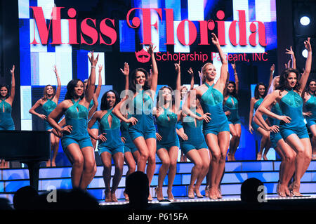 Lakeland, Florida, USA. 26th Jun, 2018. Contestants in the 2018 Miss Florida pageant perform a dance number to open a preliminary competition on June 26, 2018 at the R.P. Funding Center in Lakeland, Florida. While the national Miss America pageant announced on June 5, 2018 that they are doing away with their swimsuit competition, all the state programs within the Miss America organization, including the Miss Florida pageant,  will continue the practice this year for the final time. Credit: Paul Hennessy/Alamy Live News - Stock Photo