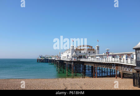 Brighton UK 28th June 2018 - Brighton Palace Pier showing off its new neon sign today after changing its name from Brighton Pier . The pier was built in the 1890s and named Brighton Marine Palace  and Pier but became known locally  as the Palace Pier until 2000 when it was rebranded Brighton Pier. Luke Johnson executive chairman of the Brighton Pier Group has now announced that it will be known as Brighton Palace Pier Credit: Simon Dack/Alamy Live News - Stock Photo