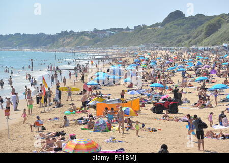 Bournemouth, Dorset, UK, 2018 Heatwave. People on sandy beach on south coast of England during hot weather. - Stock Photo