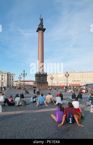 SAINT-PETERSBURG, RUSSIA – JUNE 27, 2018: People listen to the music of street musician near Alexander Column on The Palace Square - Stock Photo
