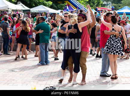 Couples dance at the Hola Asheville Festival, celebrating Latin American culture, in Asheville, NC, USa - Stock Photo