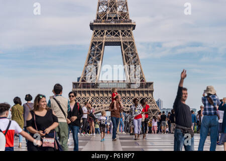 Paris, France - 23 June 2018: Eiffel Tower from Trocadero with many tourists in the foreground - Stock Photo