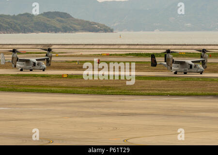 Two MV-22B Ospreys from Marine Medium Tiltrotor Squadron (VMM) 265 (Reinforced) attached to the 31st Marine Expeditionary Unit taxi down the runway at Marine Corps Air Station Iwakuni, Japan, in support of the Government of Japan's relief efforts following the devastating earthquake near Kumamoto April 18, 2016. The long-standing relationship between Japan and the U.S. allows U.S. military forces in Japan to provide rapid, integrated support to the Japan Self-Defense Forces and civil relief efforts. (U.S. Marine Corps photo by Lance Cpl. Aaron Henson/Released) - Stock Photo