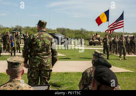 Col. Paul Moglan, the Romanian Deputy Commander of 9th Mechanized Brigade, speaks to U.S. Marines with Black Sea Rotational Force and Romanian soldiers during the opening ceremony for Platinum Lynx 16-4 aboard Babadag Training Area, Romania, April 17, 2016. During Platinum Lynx 16-4, Allies from the United States and Romania will conduct company-level tactics in order to develop proficiency in fire and maneuver.  (U.S. Marine Corps photo by Cpl. Tyler Andersen/Released) - Stock Photo