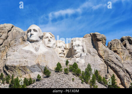 Presidential sculpture at Mount Rushmore national memorial, USA. Sunny day, blue sky. - Stock Photo