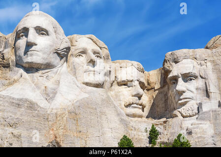 Closeup of presidential sculpture at Mount Rushmore national memorial, USA. Blue sky background. - Stock Photo