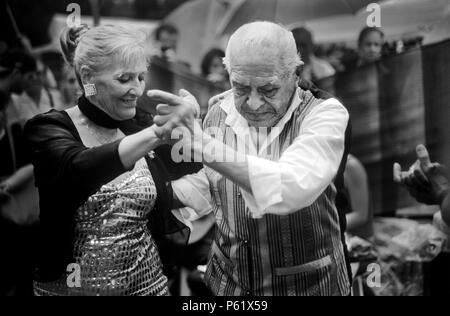 The TANGO spirit lives in the professional street dancers of SAN TELMO on PLAZA DORREGO - BUENOS AIRES, ARGENTINA - Stock Photo