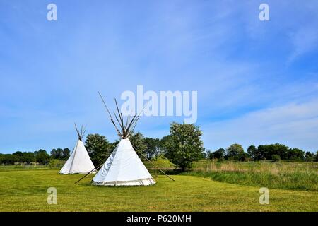 Indian tents on a meadow at a campsite in Bertingen in Germany - Stock Photo