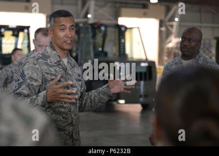 Chief Master Sgt. Terrence Greene, United States Forces, Japan and 5th Air Force command chief, speaks with Airmen during his immersion tour at Yokota Air Base, Japan, April 6, 2016. Greene now works alongside Lt. Gen. John Dolan, USFJ and 5AF commander, who he also served alongside with at the 451st Air Expeditionary Wing, Kandahar Airfield, Afghanistan,, in 2013. As command chief, Greene is the senior enlisted advisor to Dolan. (U.S. Air Force photo by Staff Sgt. Cody H. Ramirez/Released) - Stock Photo