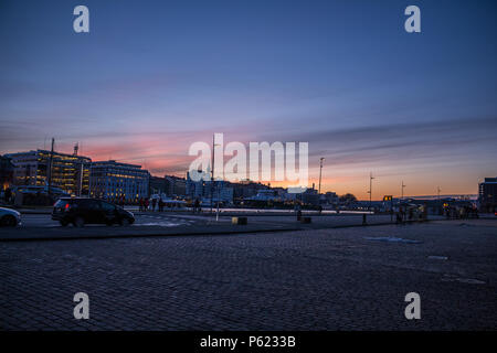 Sunset at Bergen Harbour taken facing the opposite way from the world heritage site Bryggen - Stock Photo