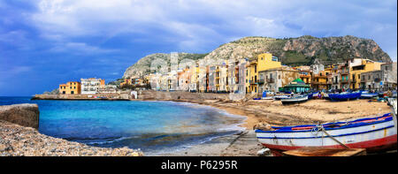 Traditional fishing boats and colorful houses in Aspra village,Bagheria,Sicily,Italy. - Stock Photo
