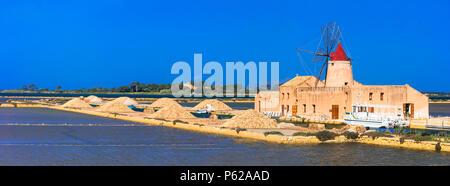 Impressive windmill and saline in Marsala,Sicily,Italy. - Stock Photo