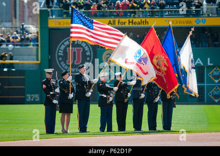 A joint service color guard presents the colors during the national anthem on field of the Pittsburgh Pirates baseball team at PNC Park in Pittsburgh, Pa., April 3, 2016. (U.S. Army photo by Staff Sgt. Dalton Smith/Released) - Stock Photo