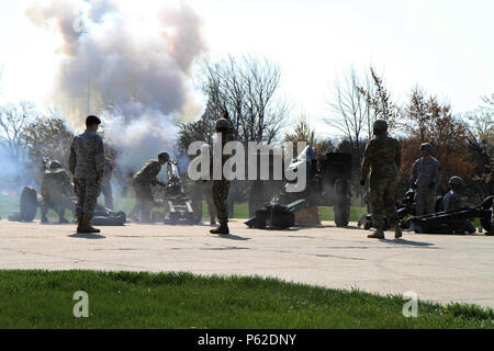 Canons roar during the 102nd Training Division (Maneuver Support) Change of Command ceremony to symbolically mark the transfer of authority from outgoing commander Brig. Gen. John Elam to the 102nd's incoming commander, Brig. Gen. Miyako Schanely, at Ft. Leonard Wood, Mo., April 3, 2016.  The 102nd trains engineers, military police, and CBRN (chemical, biological, radiological, and nuclear) soldiers across the United States. - Stock Photo