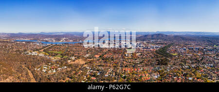 Wide elevated aerial panorama of Canberra city CBD suburb and Capitol hill federal district around lake Burley Griffin. - Stock Photo