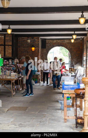 A small antiques market in the historic market hall, Amersham Old Town, Buckinghamshire, England, UK - Stock Photo