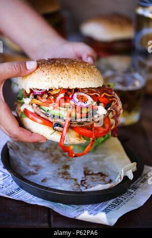 Delicious grilled portobello mushroom burger - Stock Photo