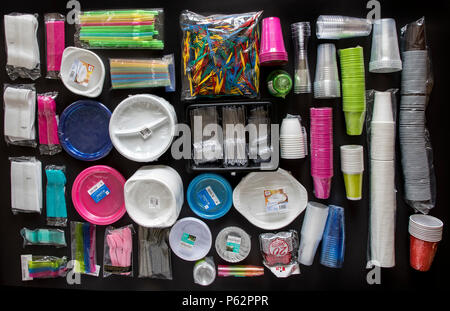 Disposable tableware, plastic utensils,  plastic cups, cutlery,  and other plastic products, plastic waste, various colors, sizes and types, - Stock Photo