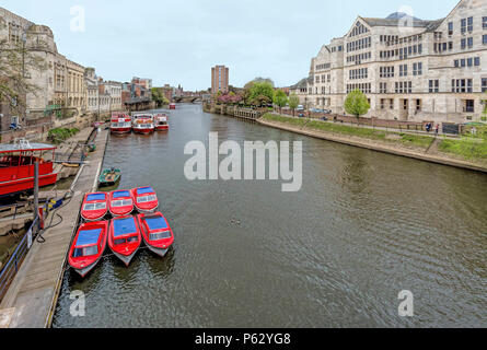 City cruise boats and red motor boats on the River Ouse in York, Yorkshire, England, United Kingdom. - Stock Photo